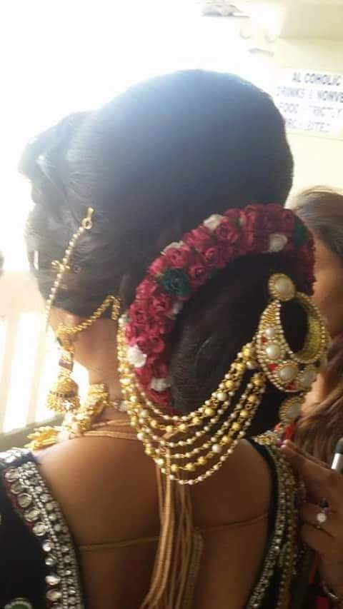 What a beautiful large low bun with real flower gajra & juda pin! Care however should be taken ...