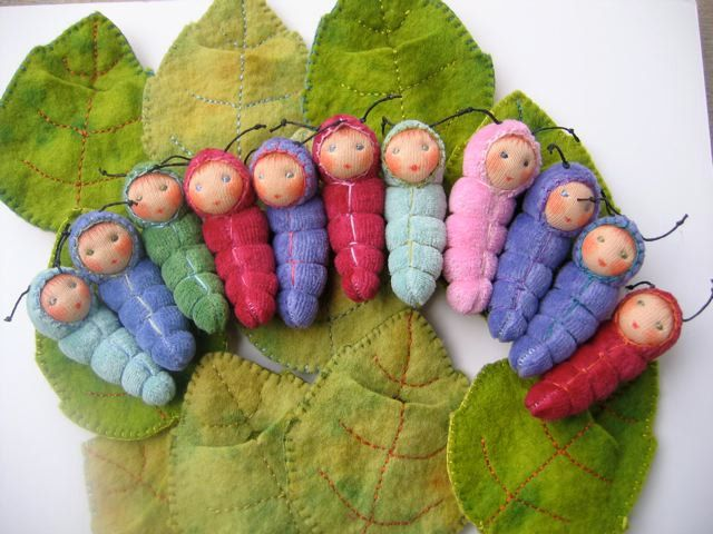 baby caterpillar dolls in a leaf bed