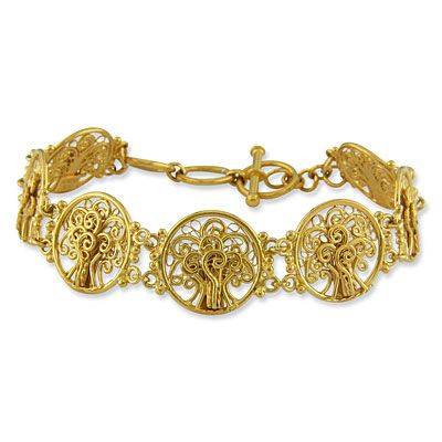 "This is an accessory that will go with any outfit at any time of day! Each of the 18mm, round links in this fabulous filigree bracelet has a Tree of Life created from fine vermeil filigree. The intricate work is expertly done. There are seven rounds measuring 18mm across that are connected to each other at two spots. The toggle closure has three ""O"" rings and makes the total length 8 1/4""."