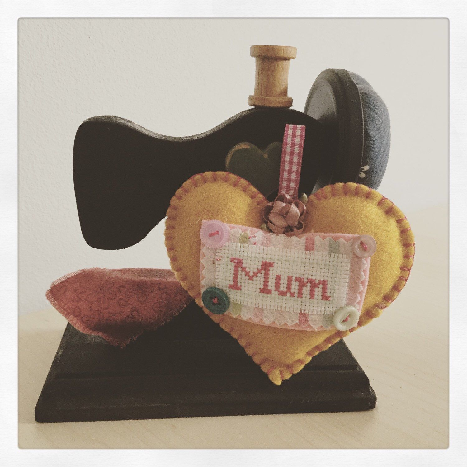 A personal favorite from my Etsy shop https://www.etsy.com/uk/listing/266890106/mum-hanging-heart-felt-decoration