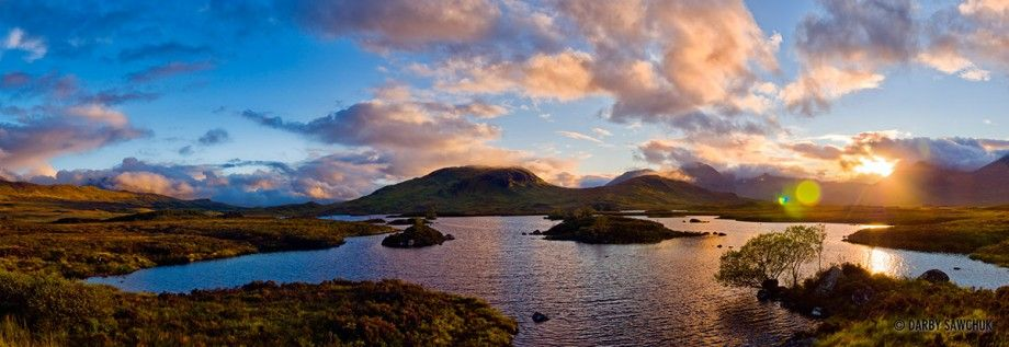 Panoramic view of the sun setting over Rannoch Moor in Scotland.