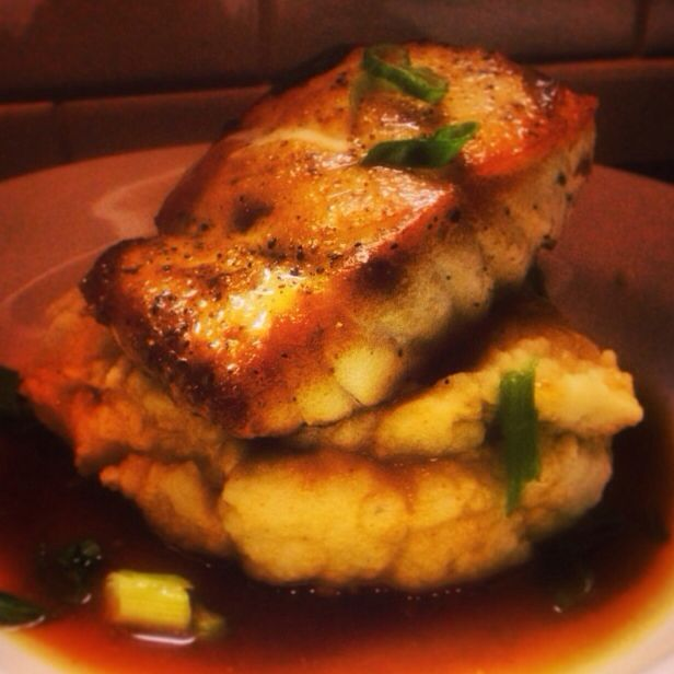 Pan seared Red Grouper served over wasabi mashed potatoes and finished with a ginger, grapefruit and soy broth.