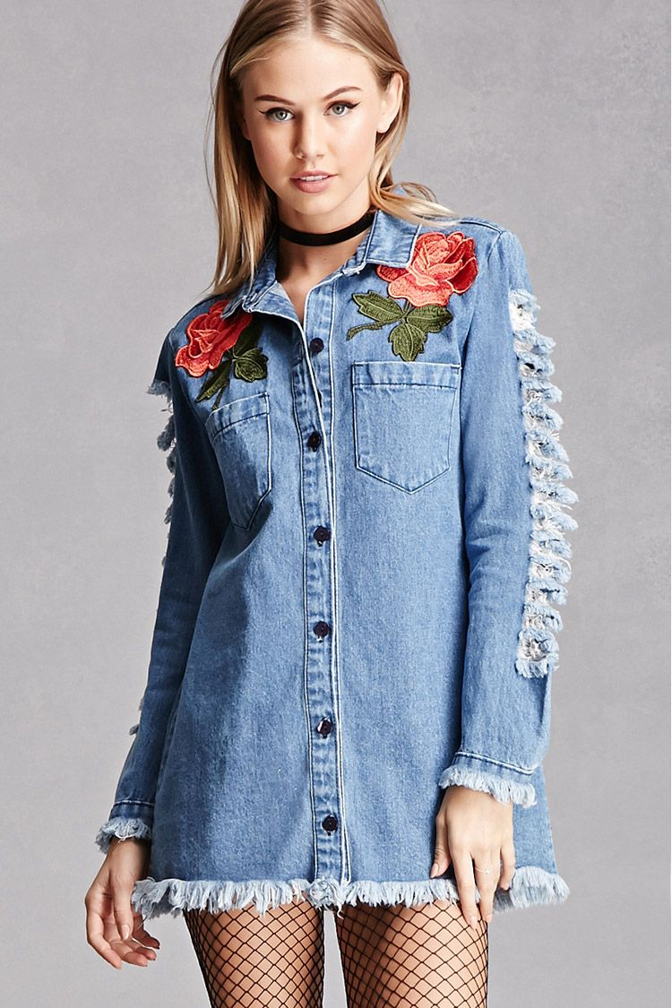 833a435ace A denim shirt dress featuring floral embroidered appliques on the chest