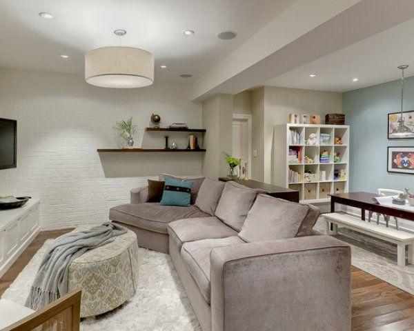 This modern basement has a cool light fixture basement