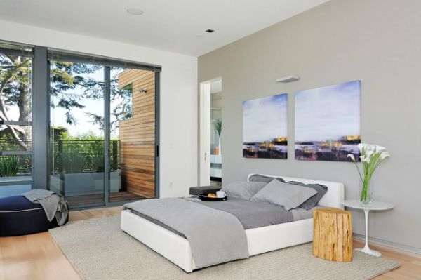 Contemporary #bedroom in neutral tones sports sliding glass doors