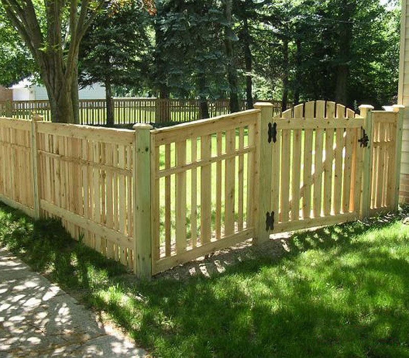 Spaced Provinicial Wood Fence With Arched Gate By Elyria Fence Wood Fence Design Backyard Fences Fence Design