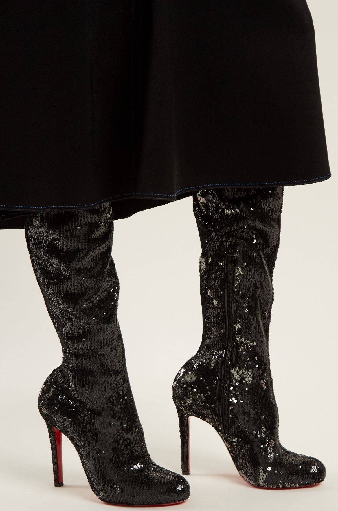 05d8d734522 This pair of Christian Louboutin black Louise over-the-knee boots is  drenched with sparkling sequin-embellishments. It sits atop a sultry 100mm  stiletto ...