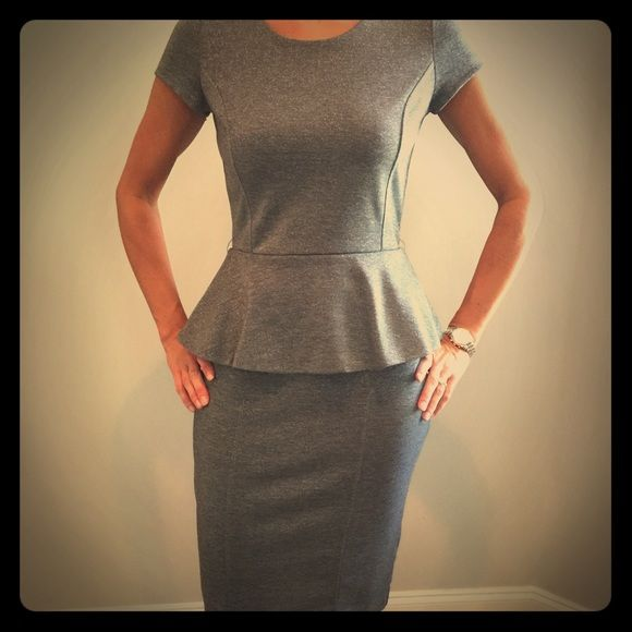 REDUCED: Dress suit This silver/gray suit is perfect for office or night. The peplum top hits the pencil skirt perfectly. Skirt is to your knees (I'm 5'7) fits more like a size 4. Wore once for a wedding. The skirt is a 2 and top is a zero. Top fits like a 2-4 New York & Company Dresses