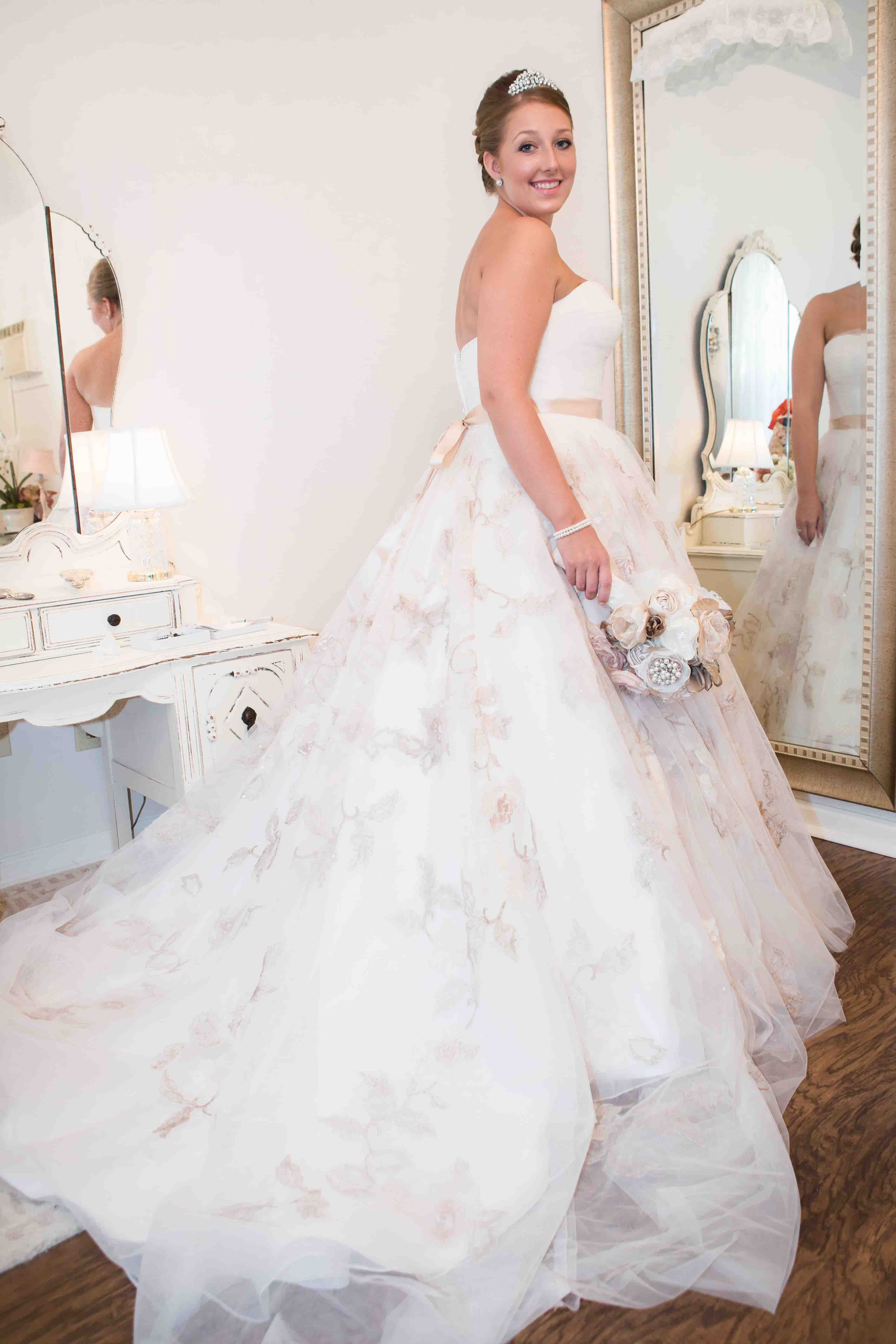 A beautiful bride getting ready in the bridal studio at