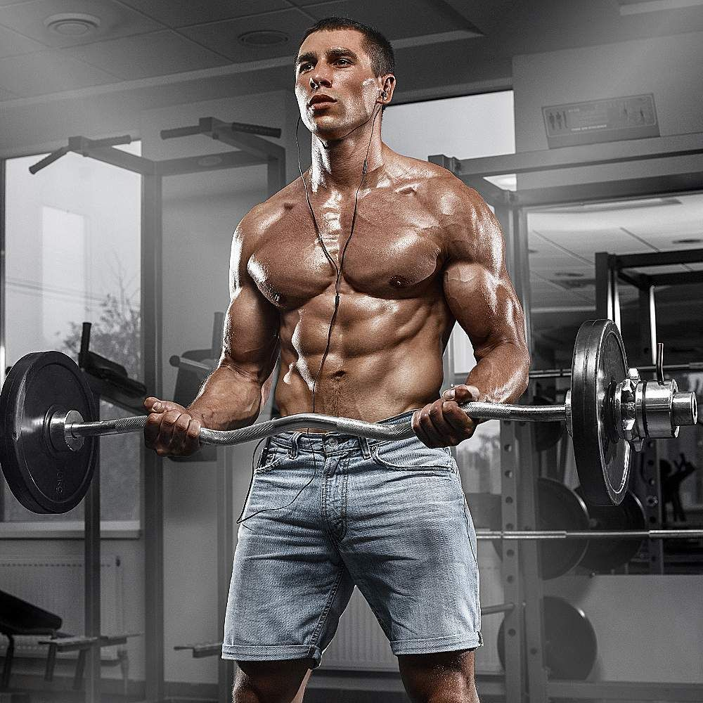 Muscular Man In Gym With Shaker Shaped Abdominal Strong