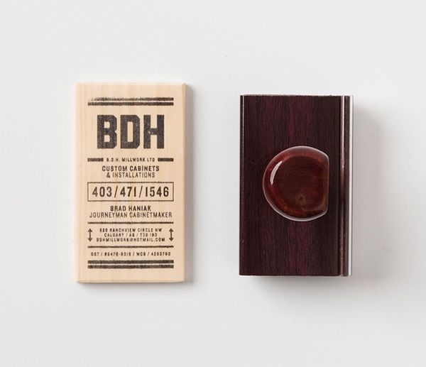 Carpenter Rubber Stamps Business Card Information Onto Wooden Blocks