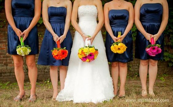 Like the dresses, and like the different colored bouquets for the ...