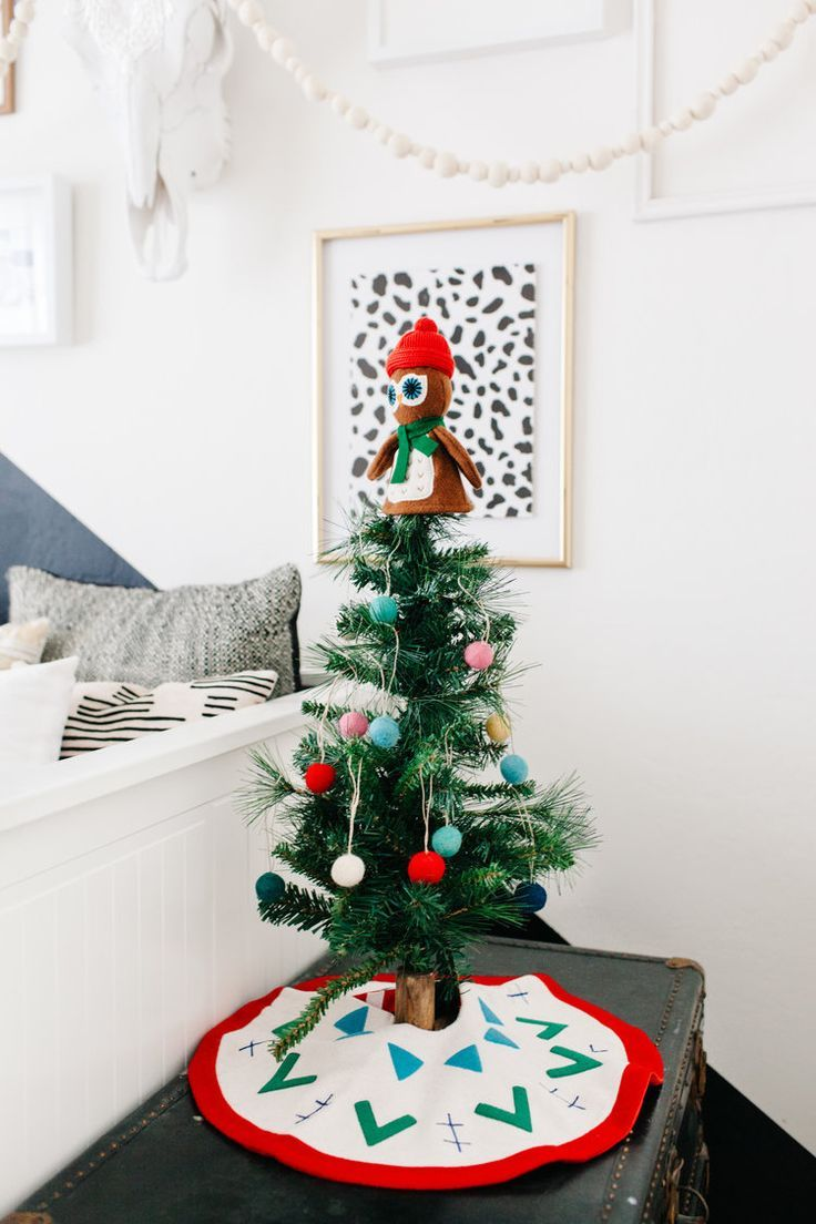 Decorating a kids room for the holidays felt ornaments kids s table top christmas tree with felt ornaments for a kids room solutioingenieria Choice Image