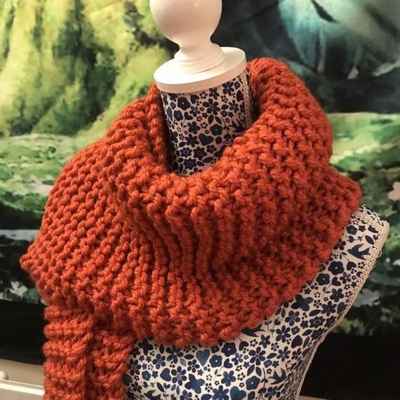 Photo of Hand-knitted warm deep orange autumn scarf