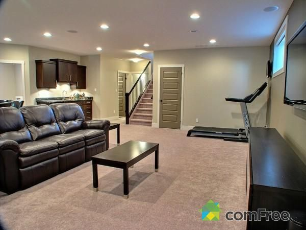 Basement Living Room Treadmill Has Tv On Wall In Front