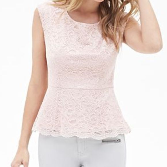 """NWT! F21 Chantilly Lace Peplum Top SZ XS  Romance and lace. No better combination for the ultimate feminine top. Sold out very quickly at F21. Pale pink allover lace with a contrast hem and pretty cap sleeves make this look like a contemporary designer piece! Discreet, concealed side zipper makes this fit like a glove. Soft cotton structured separate lining eliminates the need for additional underpinnings - maintains delicate lace look without any transparent """"see-through"""" risk. The best…"""