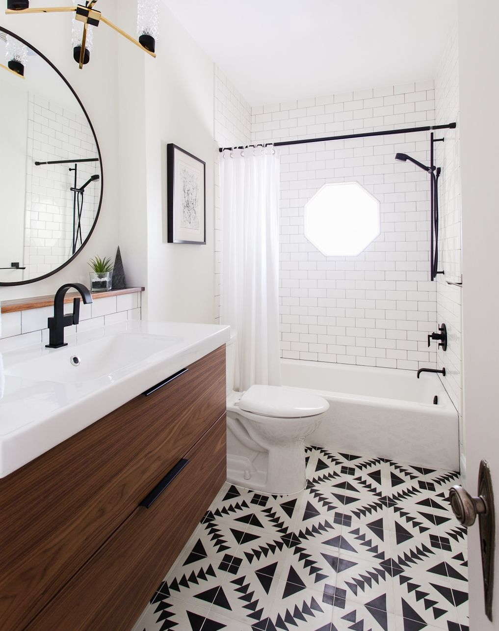 Black white bathroom pattern tile walnut vanity erin williamson walnut bathroom vanity black fixtures round mirror black and white patterned tile floor dailygadgetfo Images