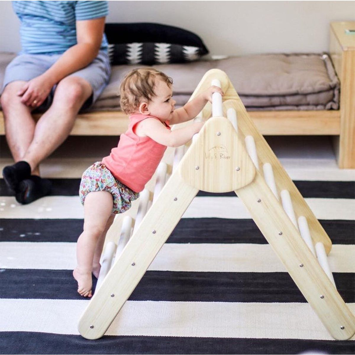The Lily & River Bamboo Climber is a fully modular climbing triangle with endless playtime combinations! The Little Climber is suitable for little crawlers, walkers, and bigger kids, and will build your little one's self-confidence, motor skill development, balance control, and muscle growth. Key features:  Frame and rungs are made from natural Bamboo Stainless steel hardware Non-toxic, VOC-free finish Folds flat for storage Suitable for indoor and outdoor day use Includes read-along board b