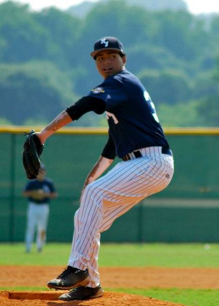 Throwing a pitch at the Perfect Game Showcase in East Cobb, GA; circa 2012.