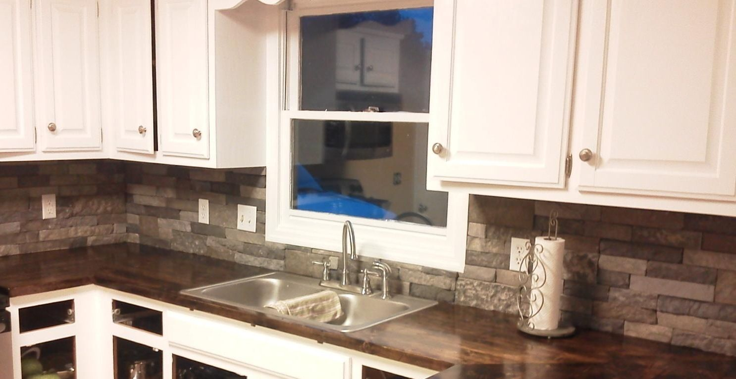 - Airstone Backsplash And Wood Countertops. Airstone Backsplash