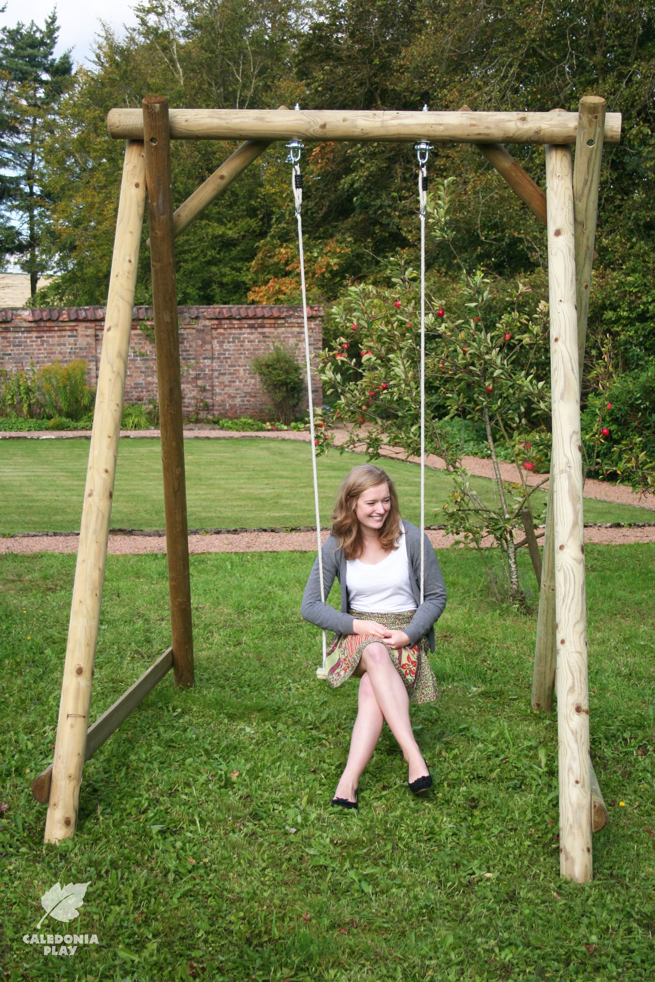Robust wooden swing frame for the garden swing seats can be