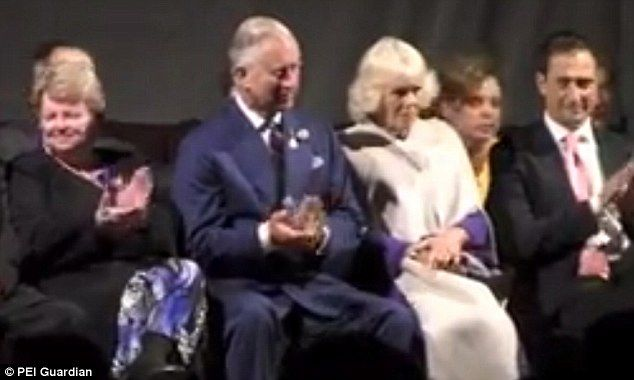 Clap: Charles managed a half-hearted applause but Camilla was having none of it