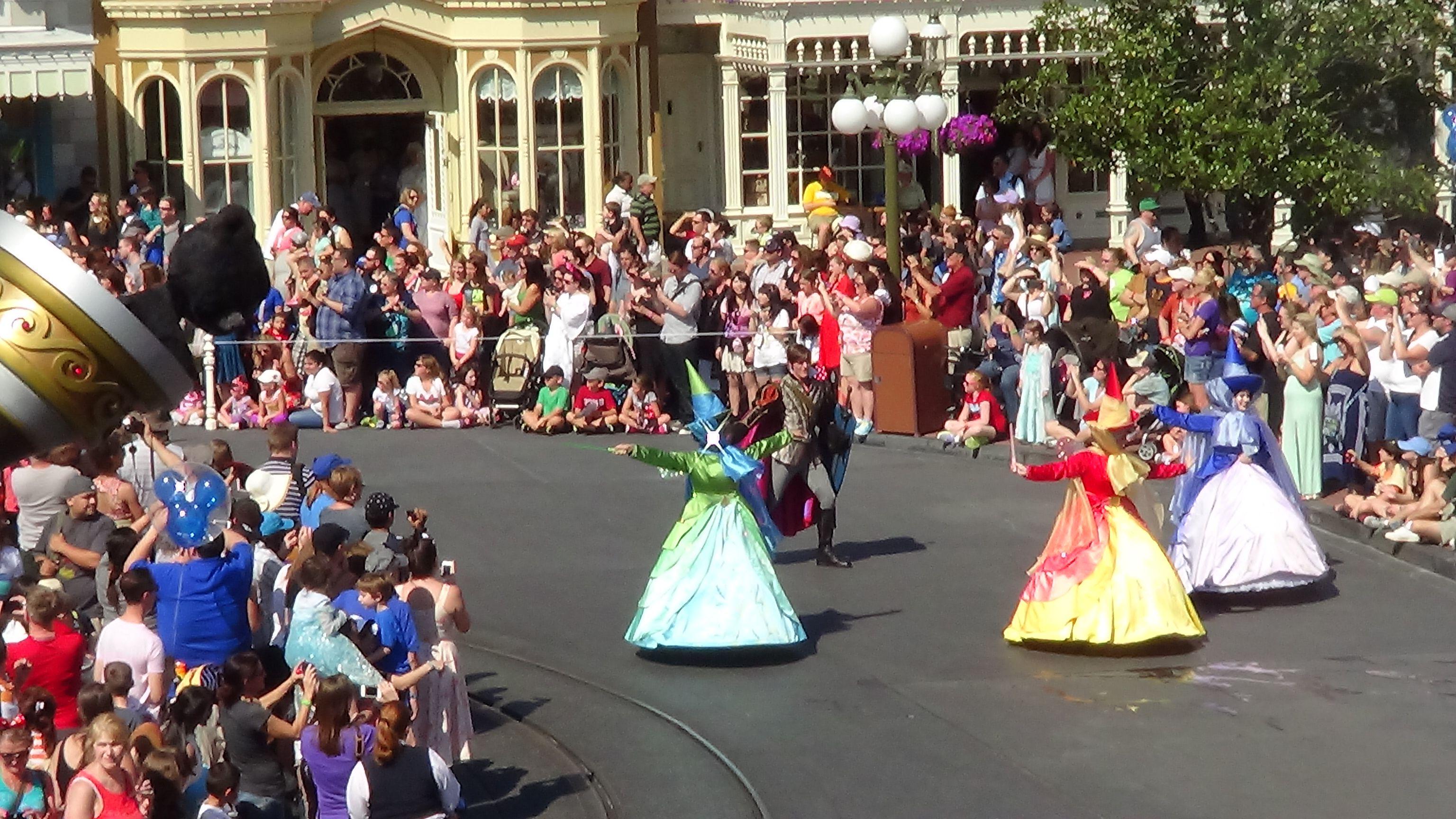 Festivaloffantasyparade Magickingdom Princess Aurora S Fairy Godmothers Flora Fauna And Merryweather Cast Some Festival Of Fantasy Parade Parades Festival