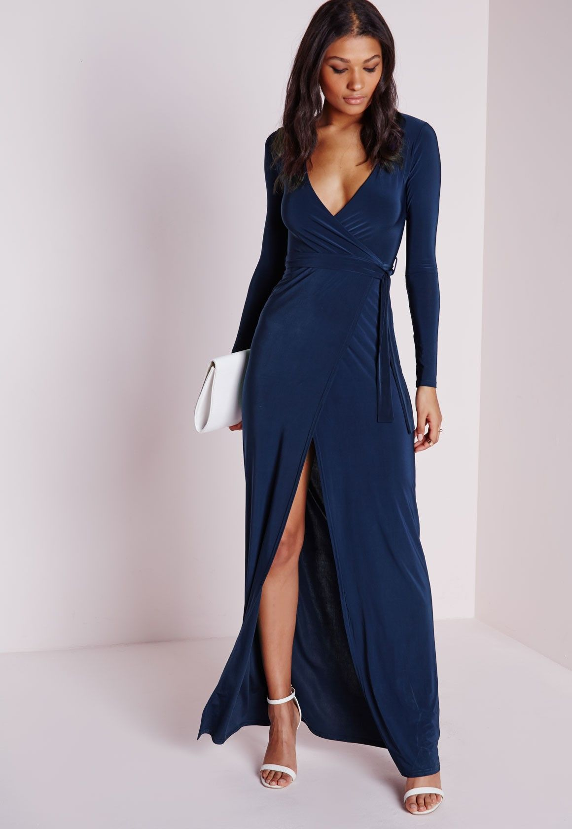 0e291b2cc6 Look seriously chic in this luscious navy maxi dress. With V neckline, long  sleeves and wrap over feature to the skirt this tie belted dress oozes  elegance.