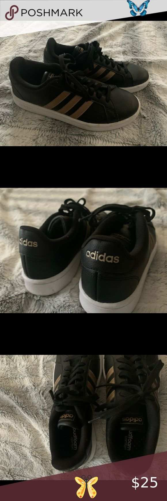 black adidas shoes with gold stripes
