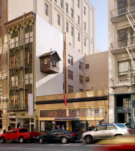Brooklyn artist Mark Reigelman and San Francisco architect Jenny Chapman have installed a wooden hut in an unusual city location – suspended on the side of a San Francisco hotel like a bird box.
