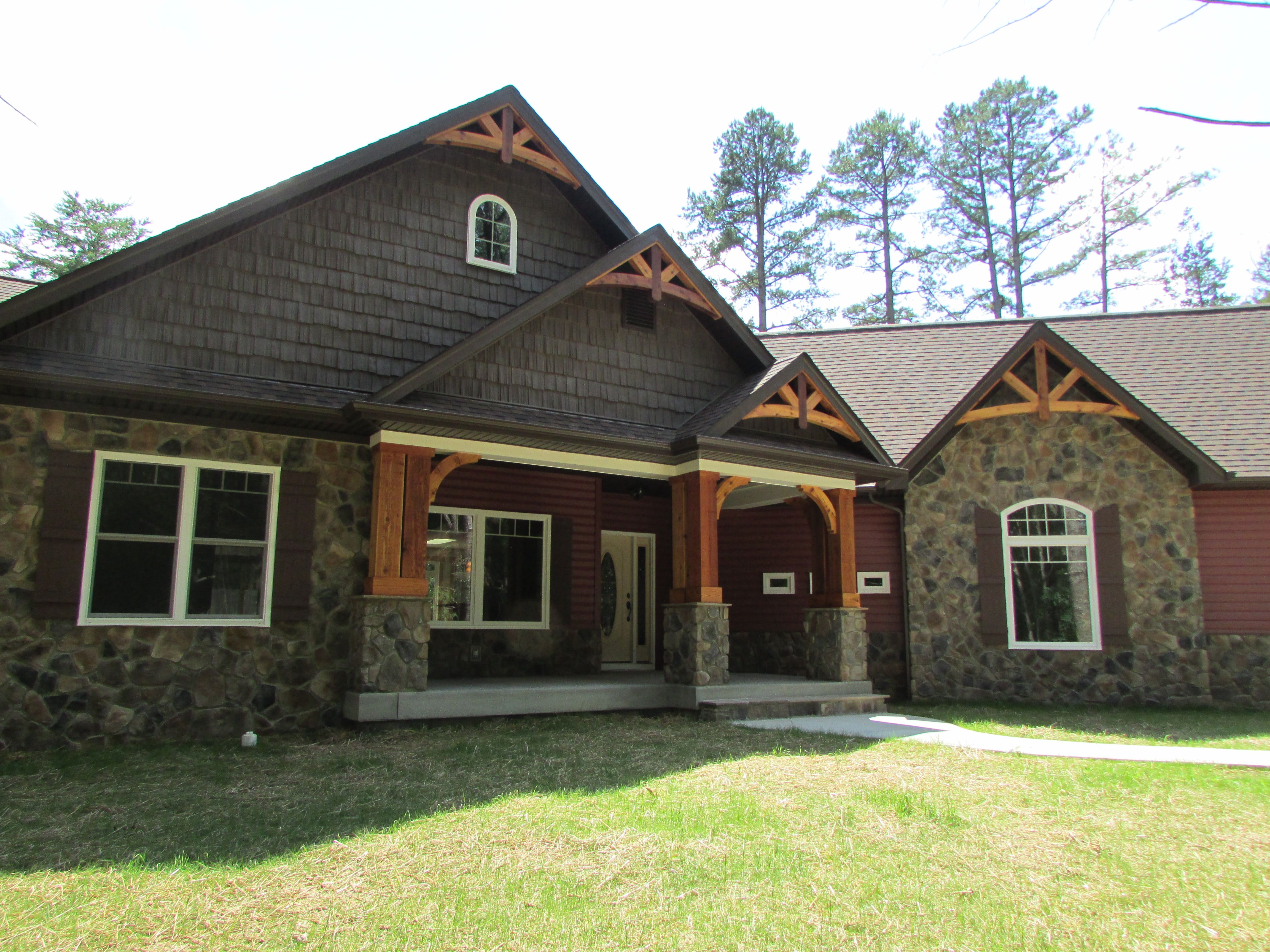 Gable And Shaker Detail Combined With Stone And Deep Red Siding Is The Picture Of A Rustic Cottage Home Ranch House Plans Rustic Exterior House Styles