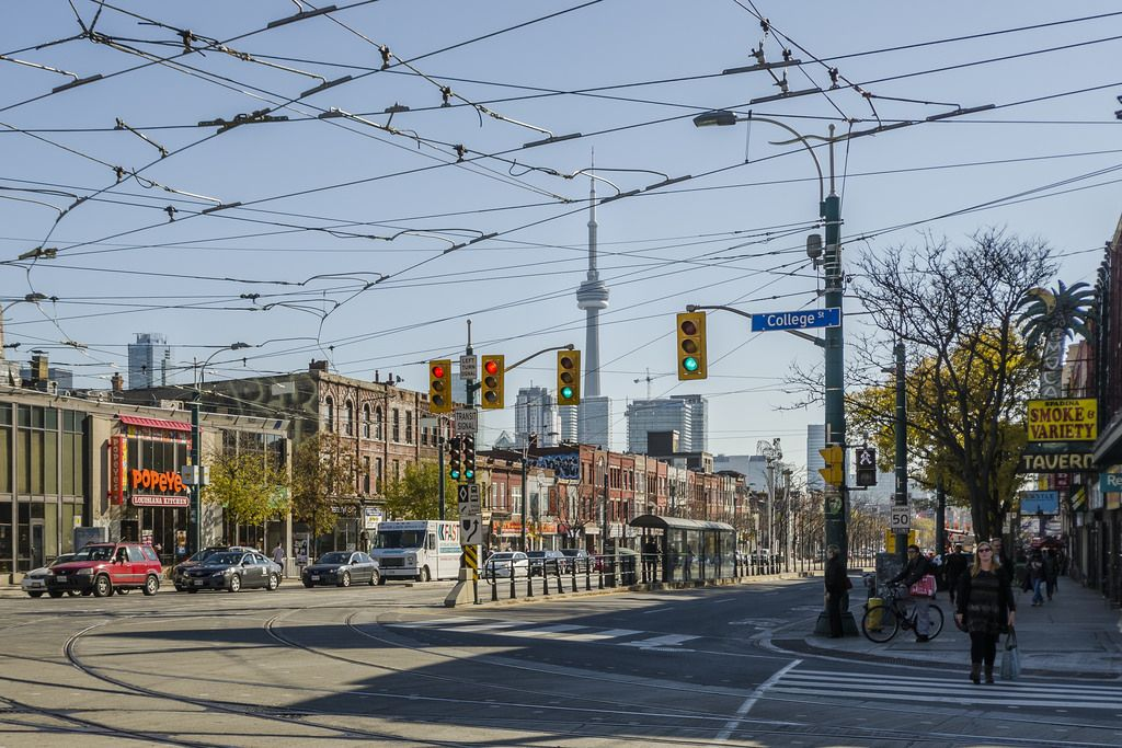 Streetcar wires above College Street and Spadina Avenue in Toronto ...