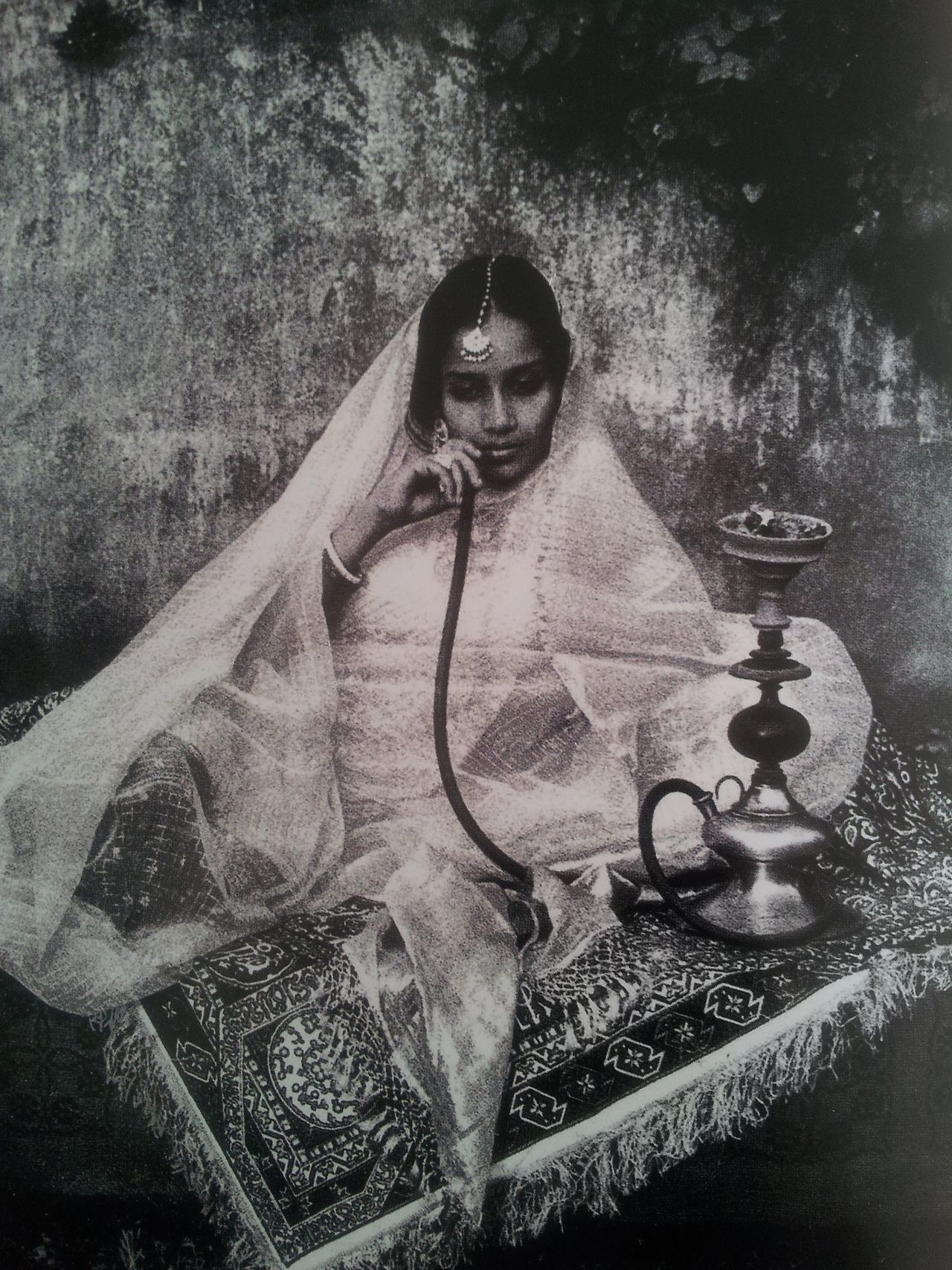 Women smoking the hookah/nargile, a common practice in Mughal India that declined by the late 19th century: 5) Nautch girl, possibly late 19th cent.