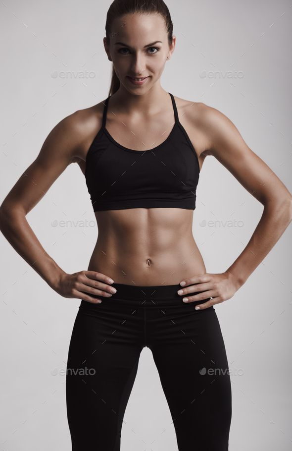 Fitness woman by erikreis. Portrait of sporty young woman with muscular body looking at camera #Affi...