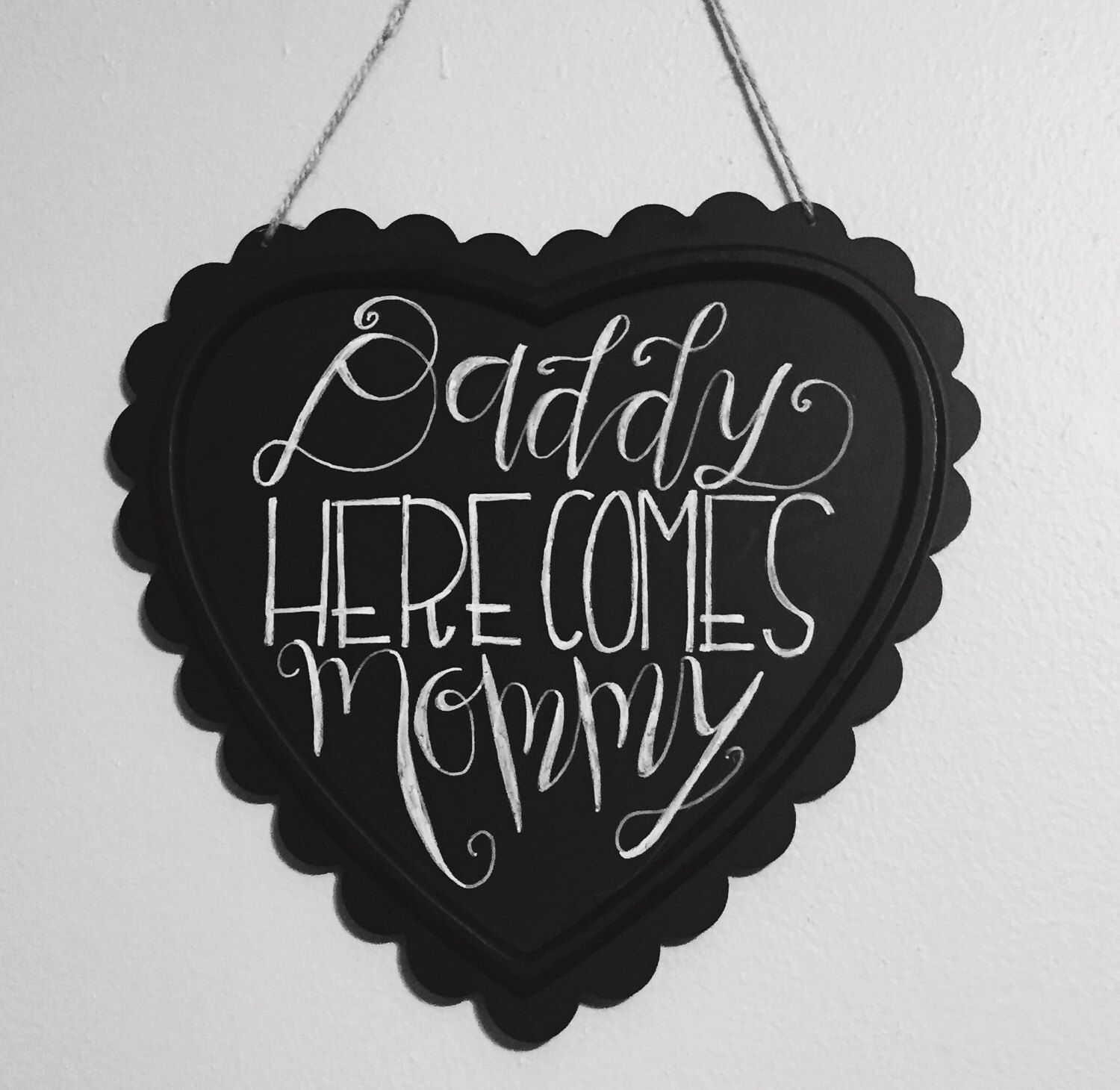 A personal favorite from my Etsy shop https://www.etsy.com/listing/265966130/daddy-here-comes-mommy-sign-with-bow