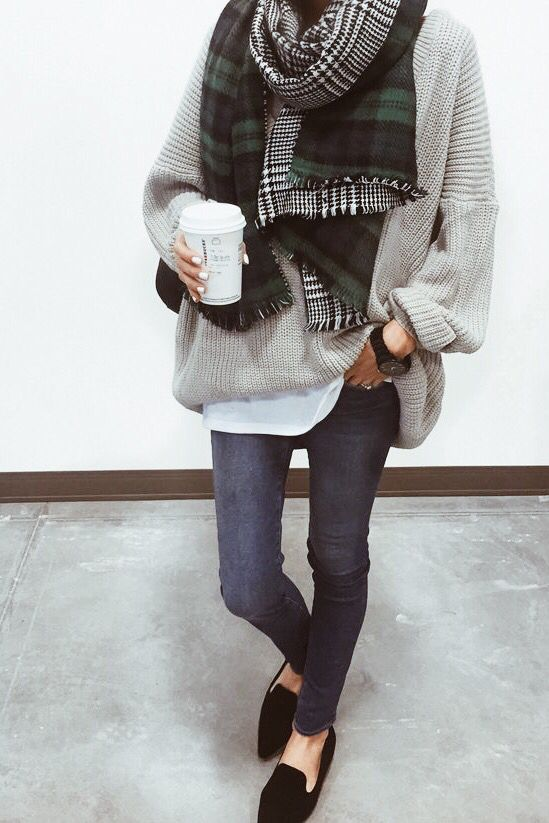 Stylishly cozy with a chunky scarf and sweater