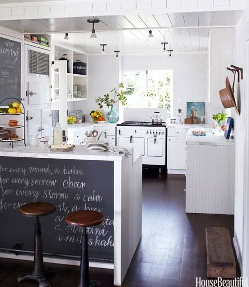 Chalkboard, white cabinets, gray countertops, cool stove, wood