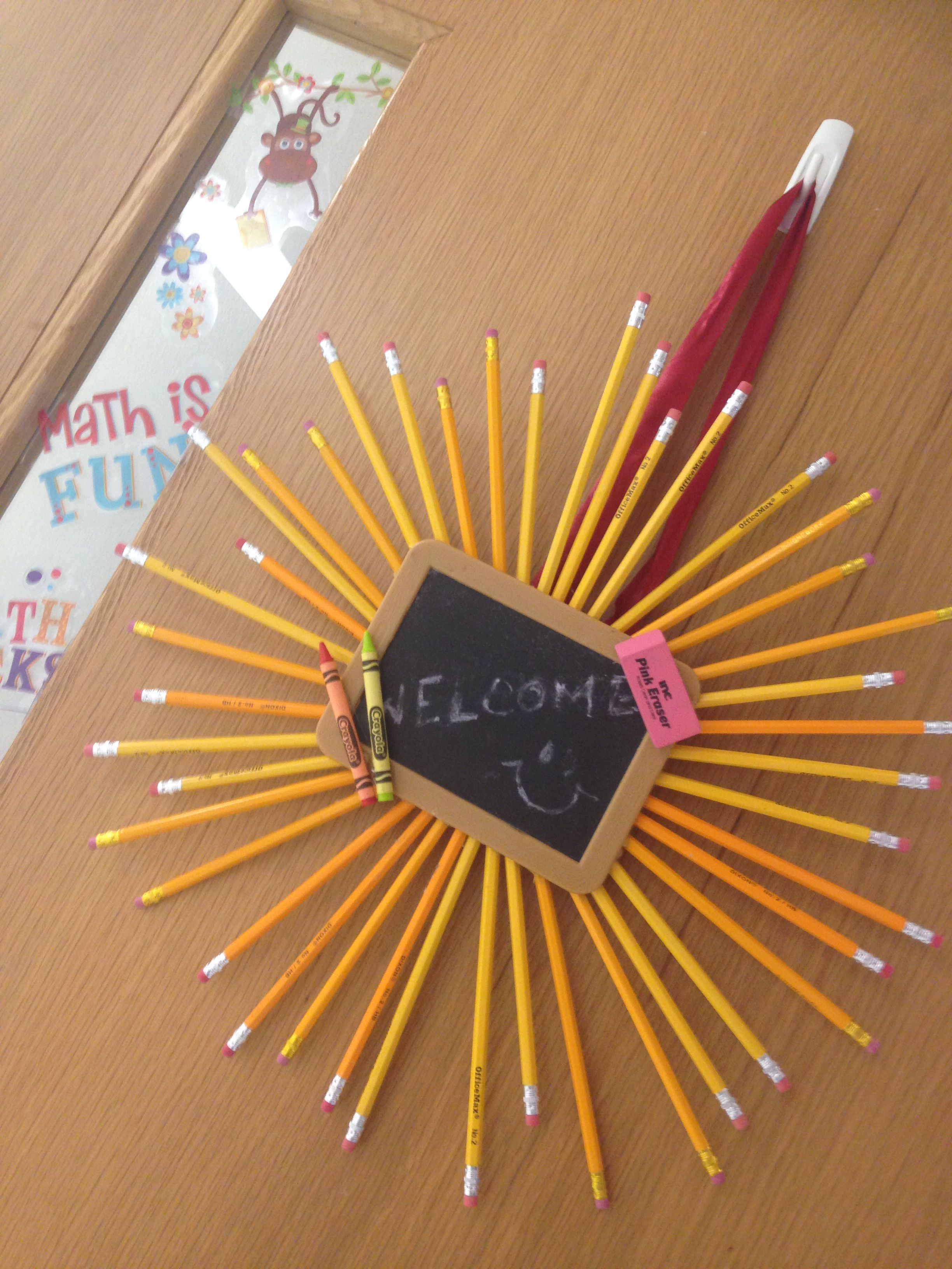 diy pencil decoration for classroom door! made using hot glue, pencils, a slate, and crayons and erasers:) its super simple to make and looks great! enjoy!