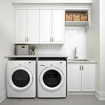 modern laundry room flooring | White Modern Laundry Room with Gray Staggered Floor Tiles ...