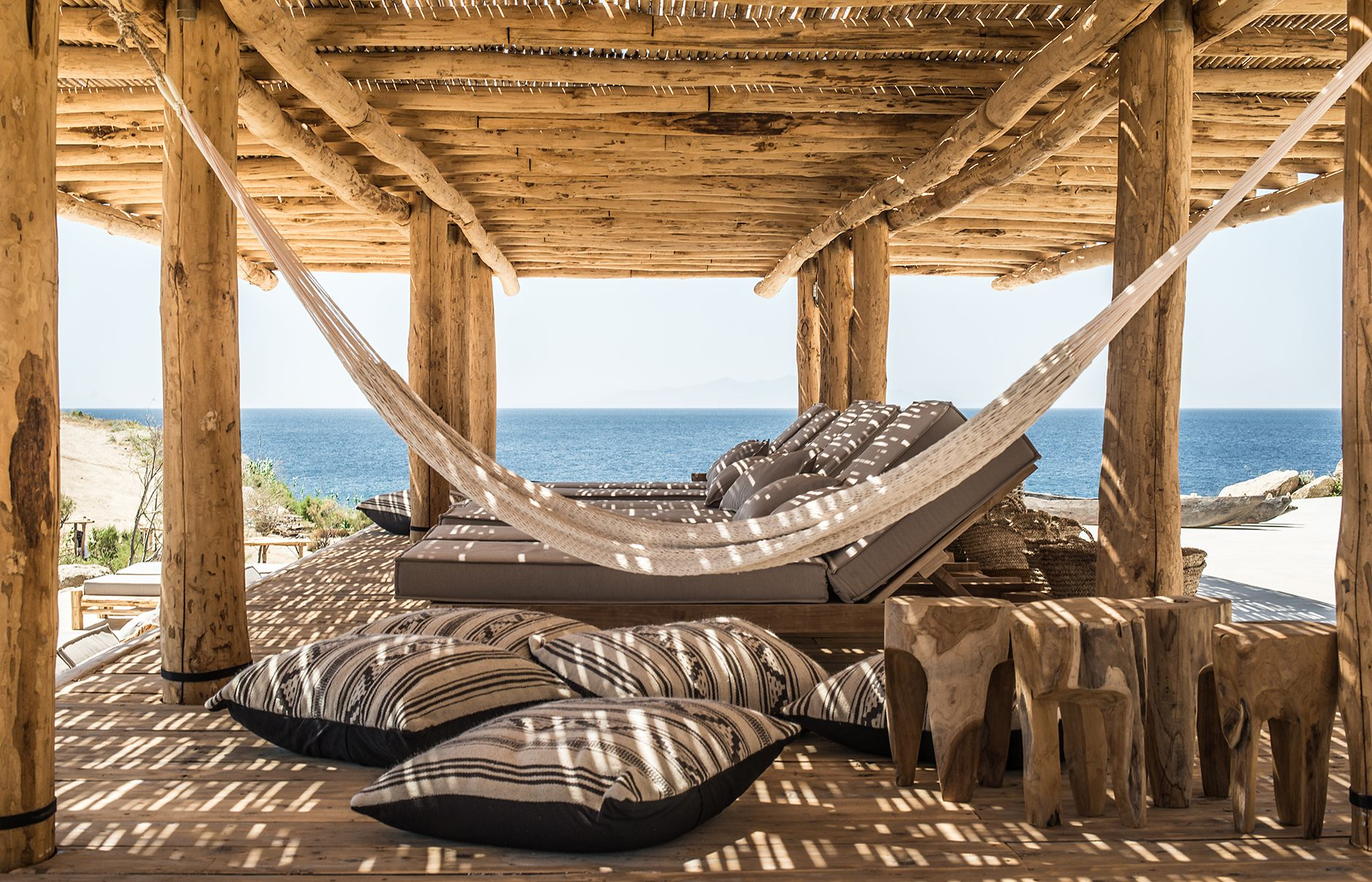 Rediscover a rustic beach experience at scorpios mykonos in greece luxury hotels • travelplusstyle