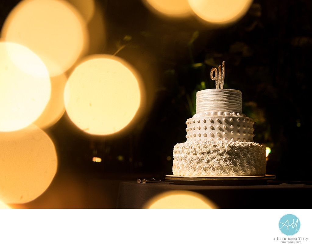 South Jersey & Philadelphia Wedding Photographer - Allison McCafferty Photography, LLC - Borgata Water Club Wedding: Borgata's Water Club is really an amazing place to have a wedding. &nbsp,Their bakery made this amazing cake which was on display front in center. &nbsp,I used some twinkle lights to isolate the cake. Location: The Water Club, 1 Renaissance Way, Atlantic City, NJ 08401.