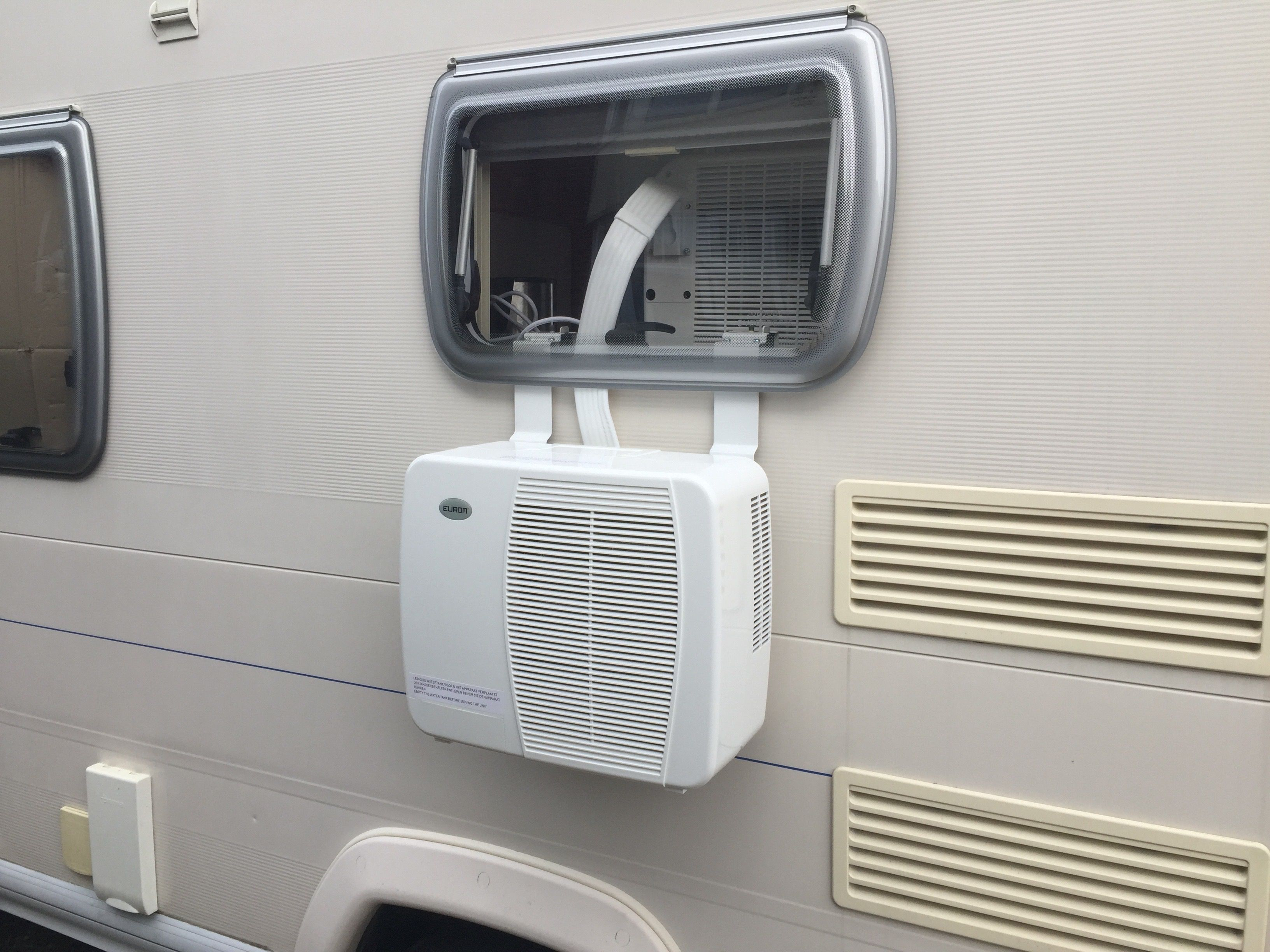 Cool My Camper air con unit shown installed on a window