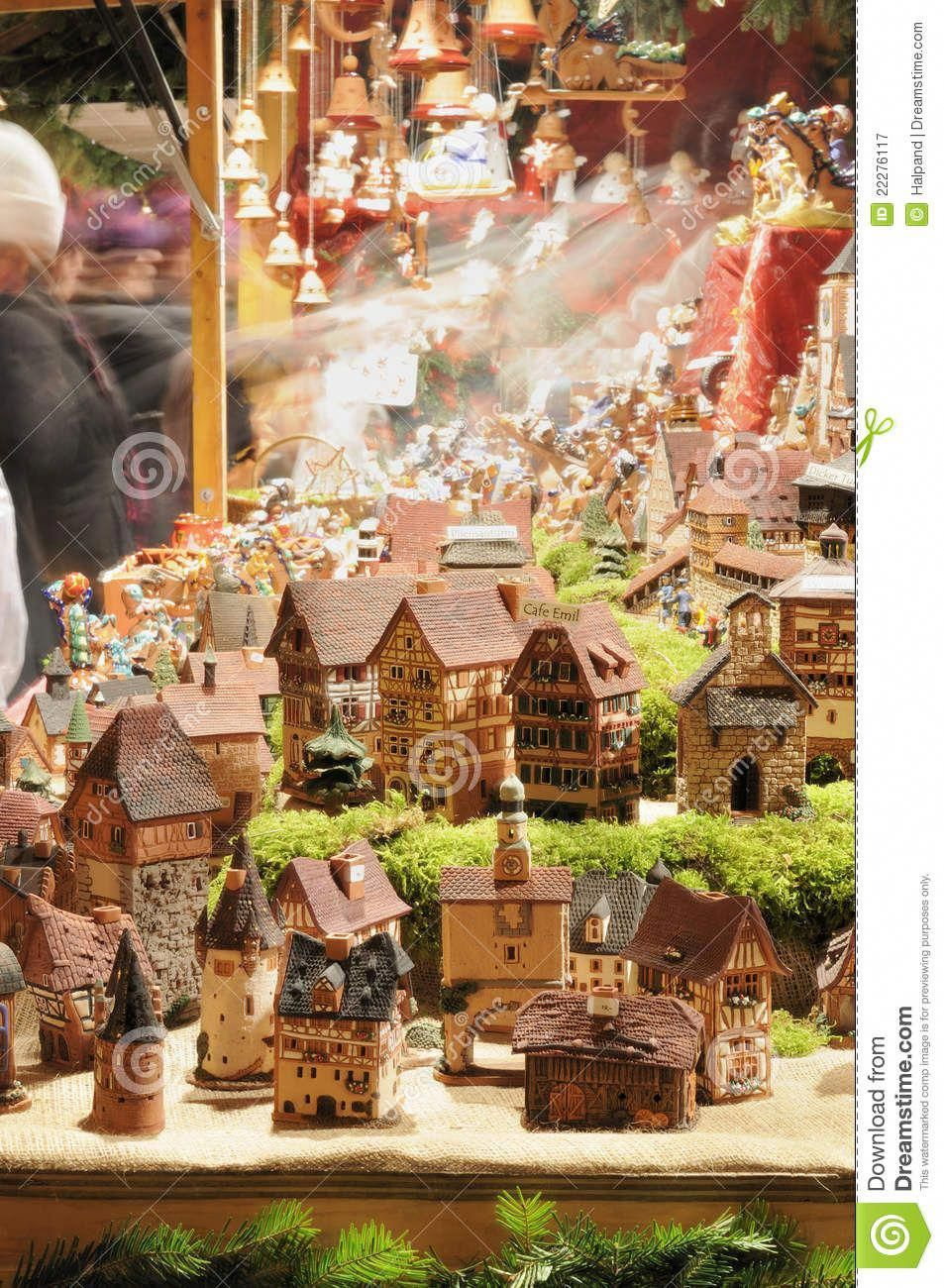 Photo about Detail, at night, of tiny model houses stand
