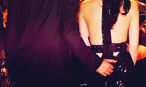 Naughty Rob. Can't take his hand off of her