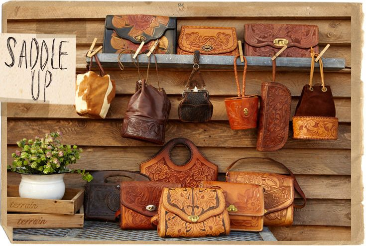 tooled leather bags.  My personal collection is at 4...3 have awesome stories behind them & they all look beautiful on the wall showing off the art that they are