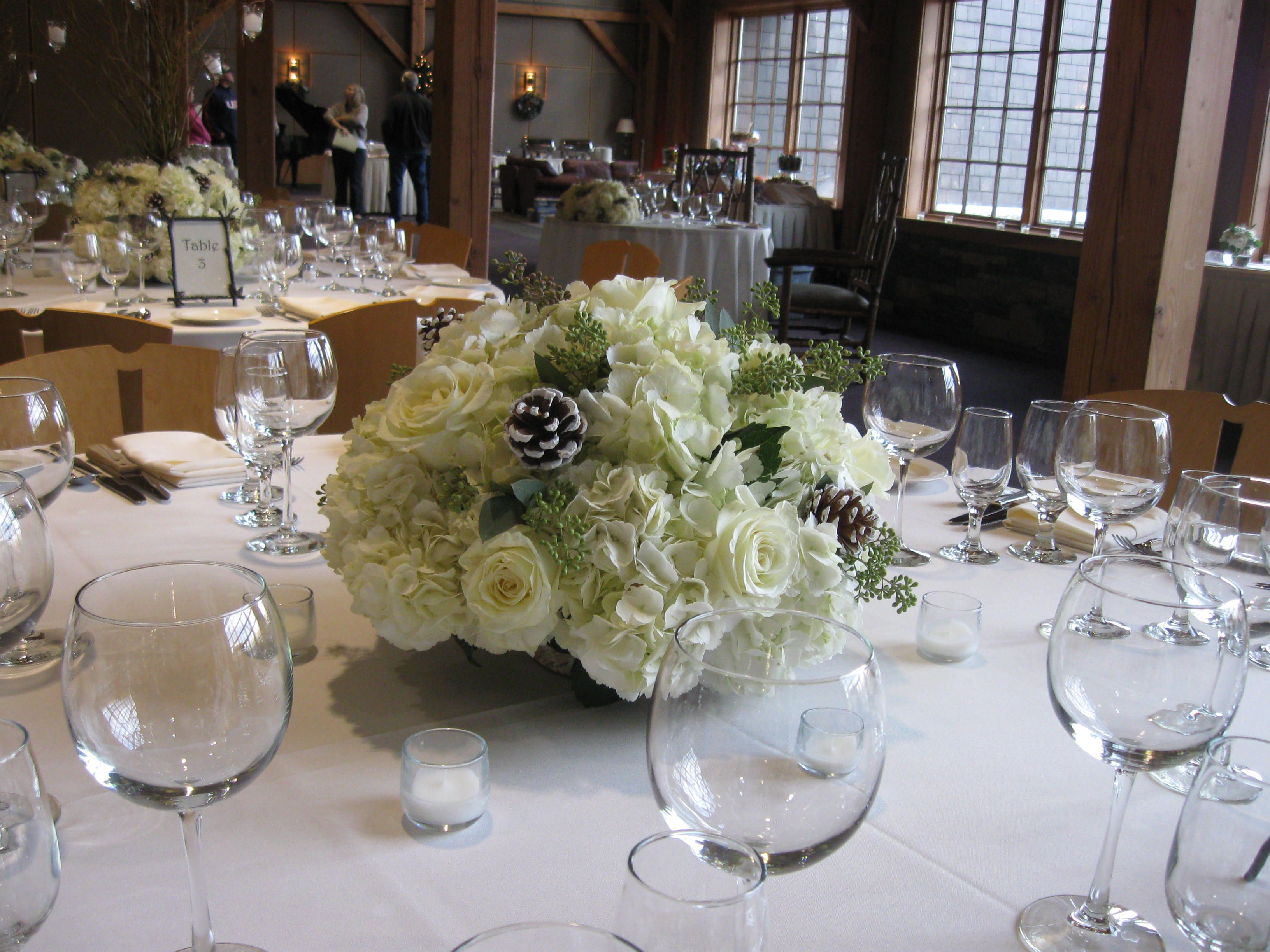 Beautiful winter wedding centerpieces of white roses