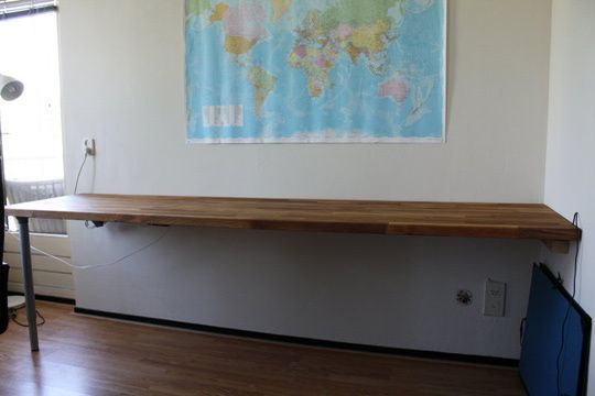 Use ikea countertop as a long desk for home office http for Wrap around desk plans