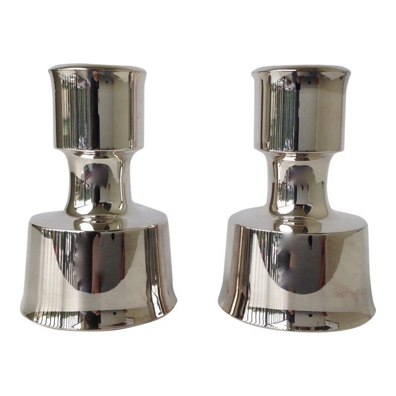 A Mid-Century, 1960's, DanishStyle pair of solid & heavy, silver plated candle holders designed by Jens Quistgaard for Dansk of Finland. One can use standard candles or 1.25