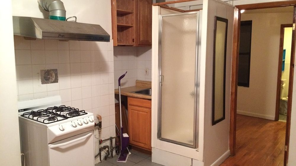 Someone Is Paying $1,795/Month For This Sad Kitchen Shower