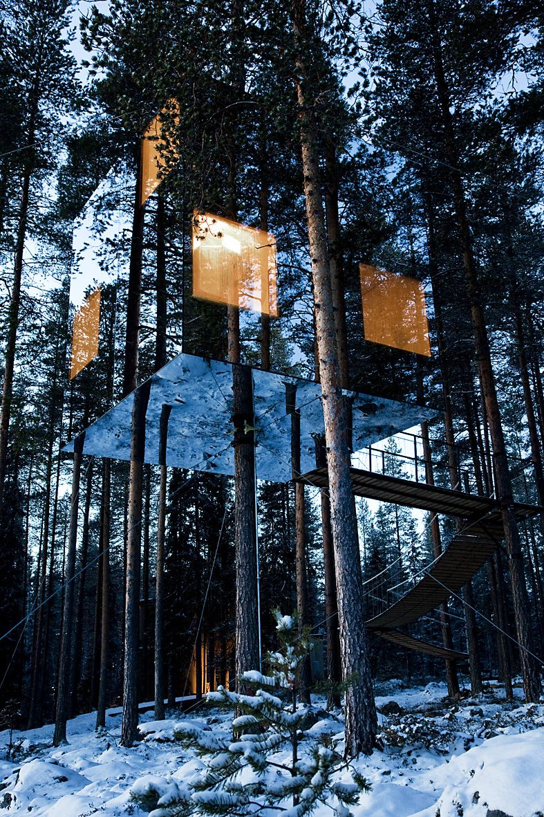 "This cube-shaped ""Tree Hotel"" in northern Sweden (close to the the Arctic Circle) is clad in mirrored glass, virtually disappearing into the tree cover.  The glass was laminated with a transparent ultraviolet color which is only visible to birds, preventing collisions. 